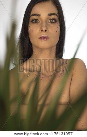 Beautiful Girl. A Girl With A Dracaena Flower