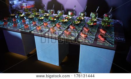 Beautifully decorated catering banquet table with different food snacks