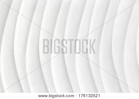 white plaster decorative tile with wavy pattern