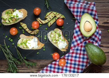 Bread With Slices Of Avocado And Cream Cheese