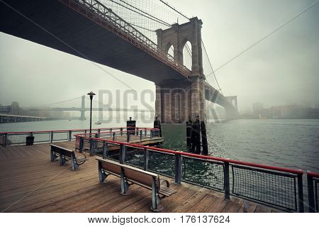 Brooklyn Bridge in a foggy day in downtown Manhattan