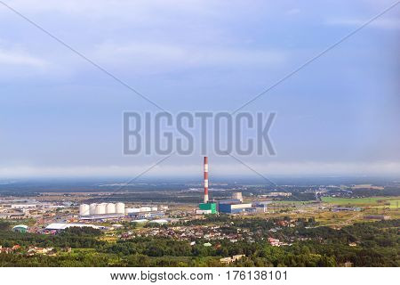 View from heights of Tallinn TV tower on Iru power plant Eesti Energia. Types and horizons of Baltic cities with altitude. Cloudy overcast sky and haze. Baltic States Estonia poster