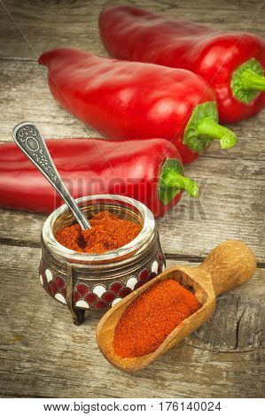 Dried red pepper. Traditional spices. Kitchen table with dried and fresh pepper. Seasoning food