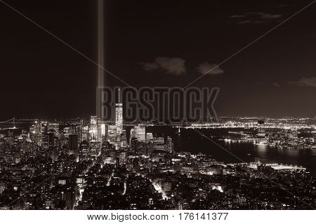 New York City downtown skyline view at night with September 11 tribute light.