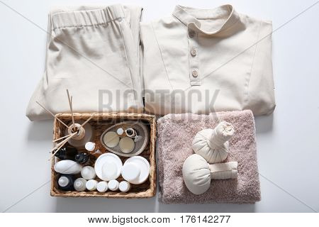 Uniform and supplies of spa specialist on white background