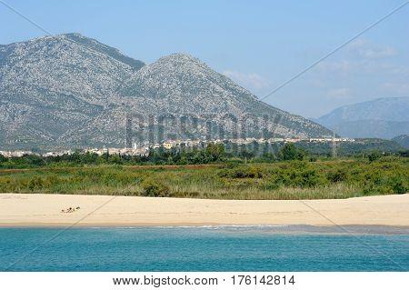 Marina di Orosei, Italy - 28 June 2013: people sunbathing at Marina di Orosei beach on Sardinia, Italy