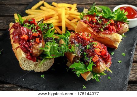 Cumberland sausage hot dogs with caramelized onion, roasted red peppers, french fries