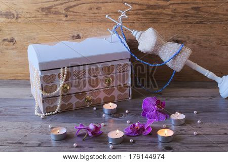 Good jewellery casket and stand-hanger. Jewellery box on wooden bekground. Beautiful jewellery box.