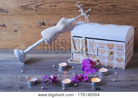 Fashion jewellery box on wooden bekground and stand-hanger. Very beautiful jewellery casket.