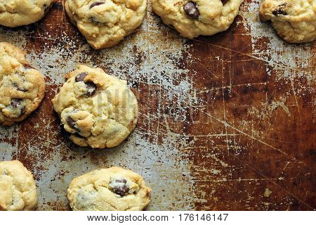 Home made chocolate chip cookies frame open tarnished baking sheet space with room for copy.