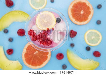 Fruits and the cocktail in a glass