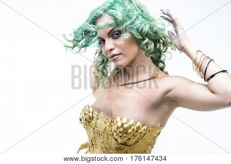 Smile, Latin woman dancing, gold dress and jewels. Young woman with her short green emerald hair