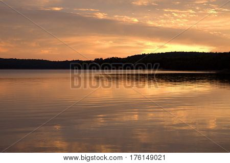 Reflection of sunset in Cedar Lake, Algonquin Park, Ontario.