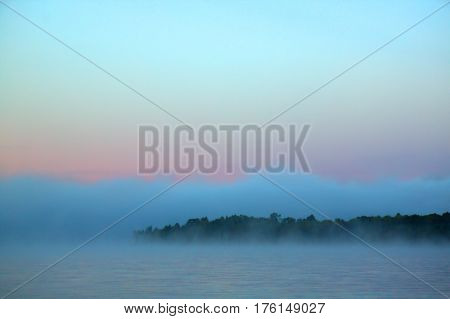 Blue-grey misty dawn at Cedar Lake, Algonquin Park, Ontario.