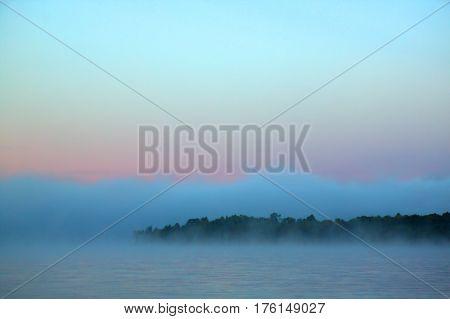 Blue-grey misty dawn at Cedar Lake, Algonquin Park, Ontario.