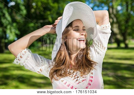 Beautiful Carefree Woman Raising Hands Above Head Laughing
