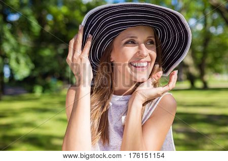 Happy Young Woman In Stylish Hat Outside Laughing
