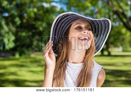 Happy Beautiful Woman In Stylish Hat Outside Laughing