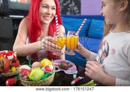 cheers with drink juice cheerful daughter and mother