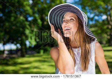 Beautiful Happy Woman In Stylish Hat Outside Looking Away