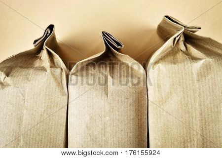 abstract background three sealed paper product bags