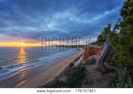 Amazing sea landscape on the mountains of Falesia. Albufeira sunset