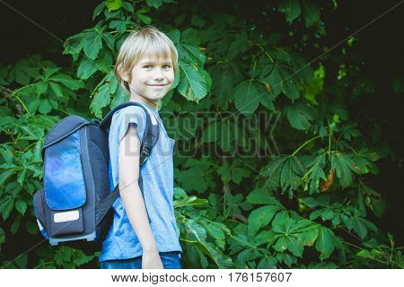 Schoolboy with a backpack going to school. Outdoor. Education, back to school, people concept