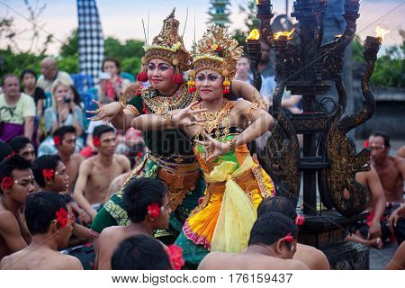 Bali Indonesia - March 03 2013: Kecak dance is a traditional ritual of Bali Indonesia.This dance is being shown at Uluwatu Temple.Blurred appearance of flowing dance.