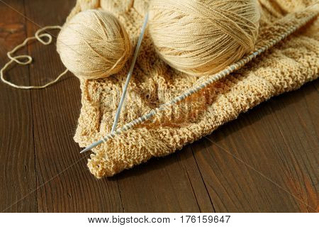 Knitting Spokes With Ball Of Wool On Table