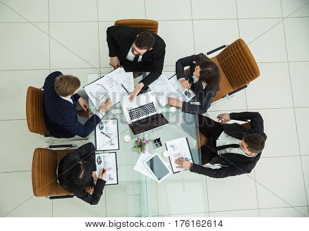 view from the top - CEO and the business team at a working meeting in a modern office.