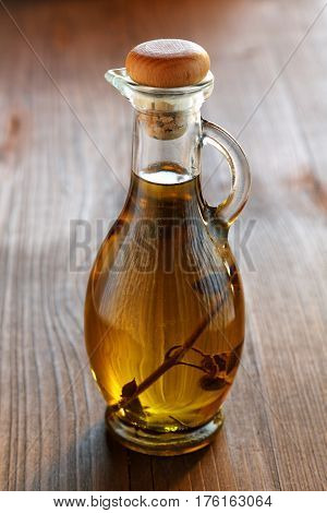 Olive Oil Bottle On A Rustic Table
