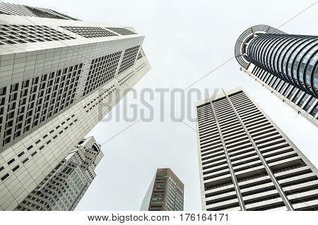 Several skyscrapers on the sky background in Singapore. View from below. Horizontal.