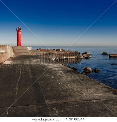 Red Lighthouse On Breakwater Dam