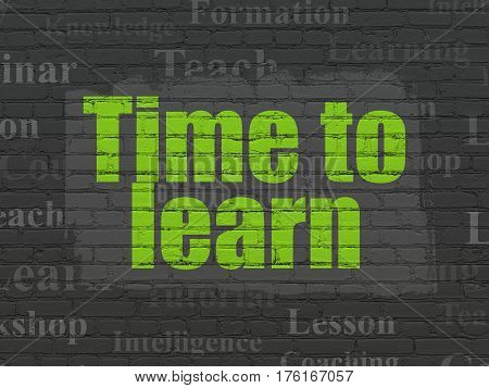 Studying concept: Painted green text Time to Learn on Black Brick wall background with  Tag Cloud