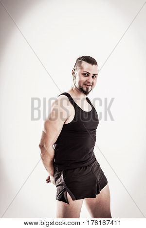 charismatic trainer on bodybuilding on a light background. the photo has a empty space for your text