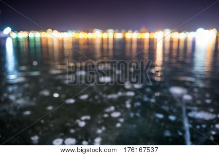 Blurred Perspective Iced Lake At Night City