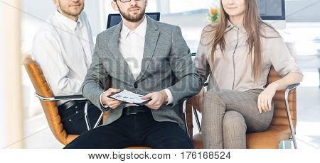 business team with financial schedules in the workplace in the office.the photo has a empty space for your text.