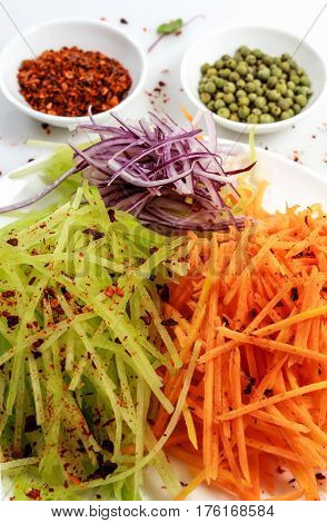 Vegetables sliced for Korean salad with pepper. Still life in high key.