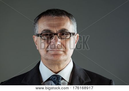 Attractive Middle-aged Businessman In Glasses
