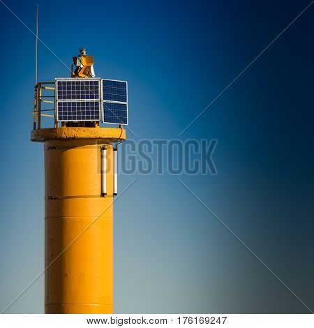 Yellow Lighthouse On Breakwater Dam