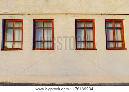 Wall With Four Wooden Windows