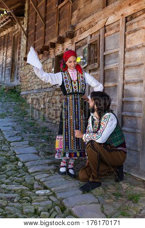 Young Bulgarian couple showing traditional folklore dancing in Zerevna village