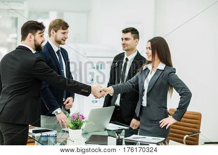 company's lawyers and a handshake of business partners after signing the contract in the workplace in a modern office.the photo has a empty space for your text