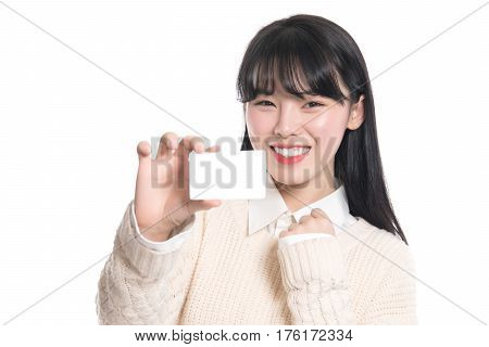Studio portrait of twenties Asian woman happily having a card