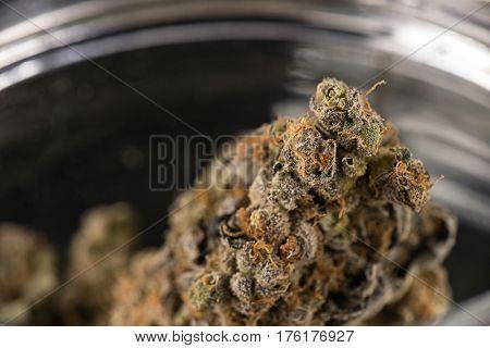 Macro detail of cannabis buds (maui skunk strain) on a glass jar - medical marijuana concept