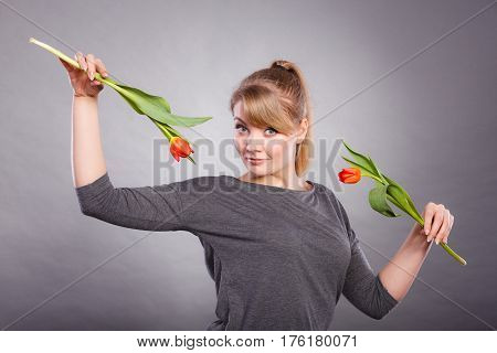 Playful Girl Having Fun With Flowers Tulips.