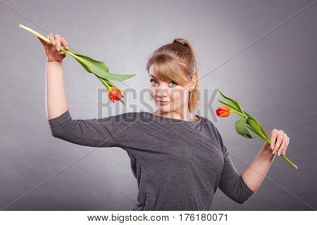 Playful Girl Having Fun With Flowers Tulips.