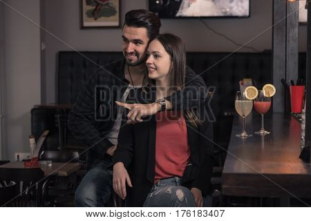Man Hugging Woman, Couple Friends, Pointing Finger, Pub