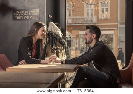 Young Couple Sitting Caffee Shop Indoors, Holding Hands