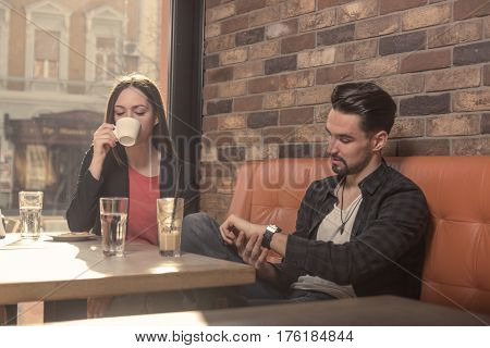 Young Woman Man, Drinking, Looking At Watch Caffe